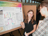 Earth Intern Orly Stampfer discusses her research with Scarsdale High School student Eric Perfetti,  at the Earth Intern poster session.