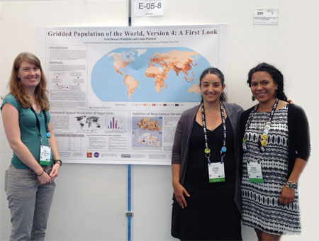 CIESIN geospatial information specialists Erin Doxsey-Whitfield, Dara Mendeloff, and Linda Pistolesi standing in front of the poster they created describing development highlights of the fourth version of the Gridded Population of the World (GPW) data set.