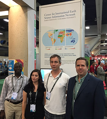 CIESIN staff standing in front of exhibit booth at 2016 Esri User Cionference