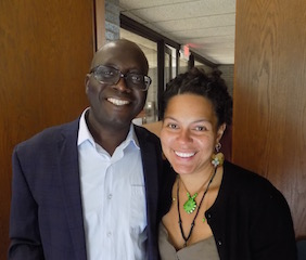Dr. Malanding Jaiteh with fellow geographic information specialist Dara Mendeloff