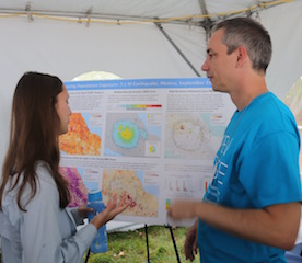 Columbia graduate student Christina Paton discusses Mexico earthquake exposure with staff member John Squires