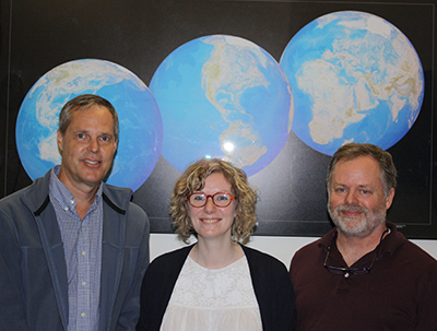 Lucille Maertens, postdoctoral fellow at CIESIN (center), standing with CIESIN associate director for science applications Alex de Sherbinin (left) and deputy director Marc Levy (right)