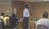 Malanding Jaiteh teaching technical workshop on developing the Natural Resource management Indicator at GDEST conference