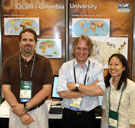 associate director Mark Becker and geographic information specialists Greg Yetman and Tricia Chai-Onn in front of CIESIN's exhibit at the 28th Annual ESRI International User Conference.